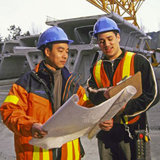 Workers reading blue prints
